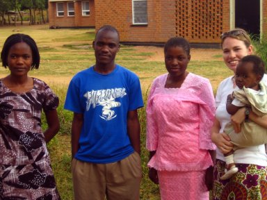 Me with my Counterpart, Frederick and his family in front of the Mkanda Health Center